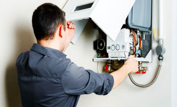 plumber installing a boiler for emergency call out customer in ayr